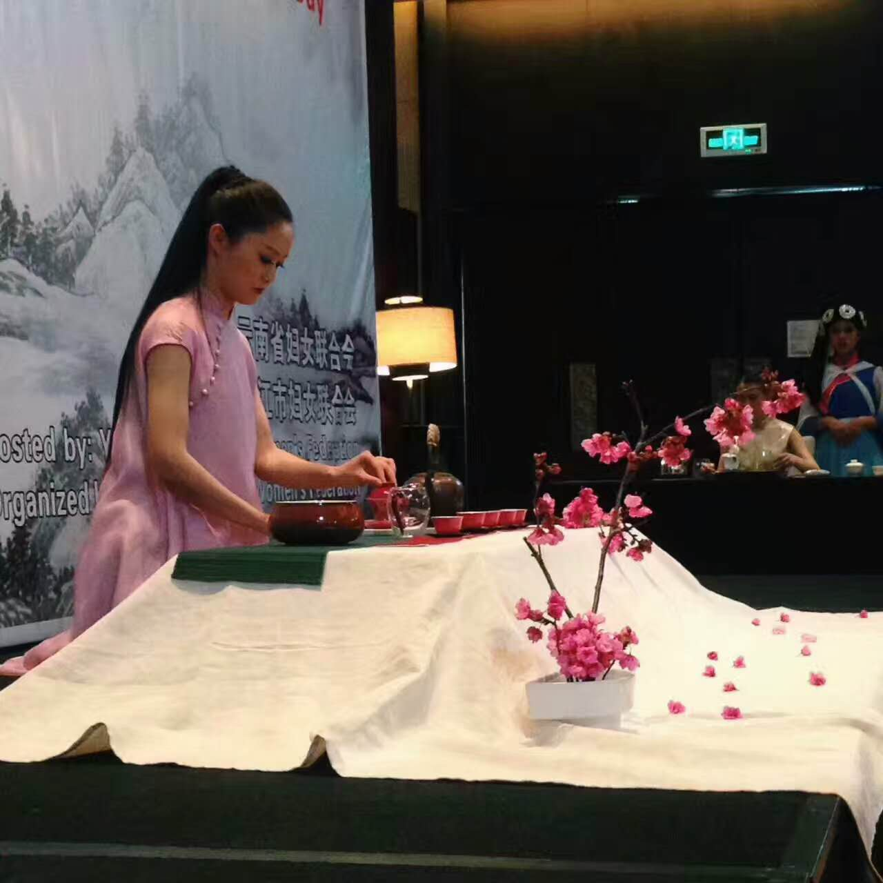 Lilizhen is showing the traditional tea ceremony
